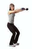 Sportswoman with dumbbells Royalty Free Stock Photography