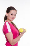 Sportswoman with dumbbells inflates his right hand Stock Images