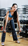Sportswoman with dumbbells Royalty Free Stock Photo