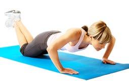 Sportswoman exercising Stock Photos