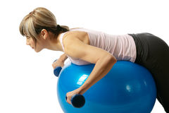 Sportswoman exercising on a Fitness Ball Stock Image