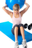 Sportswoman exercising on a Fitness Ball Royalty Free Stock Photography