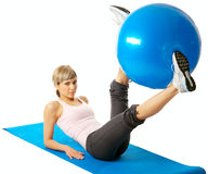 Sportswoman exercising with a Fitness Ball Royalty Free Stock Photography