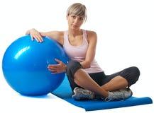 Sportswoman exercising on a Fitness Ball Royalty Free Stock Photos
