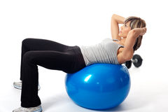 Sportswoman exercising on a Fitness Ball Stock Photography