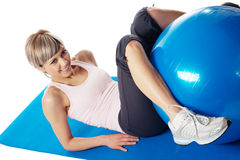 Sportswoman exercising with a Fitness Ball Stock Photography