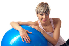 Sportswoman exercising on a Fitness Ball Royalty Free Stock Images