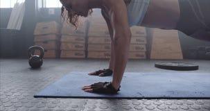 Sportswoman exercising push-ups at the gym stock video