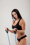 Sportswoman exercising with a resistance band on Stock Photos