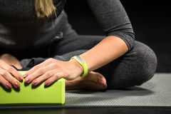 Sportswoman exercising with yoga block Stock Photography