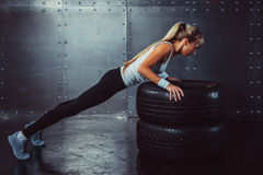 Sportswoman. Fit sporty athlete woman doing push Stock Image
