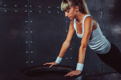 Sportswoman. Fit sporty athlete woman doing push Royalty Free Stock Photos