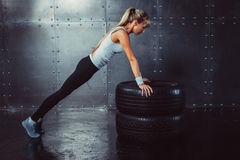 Sportswoman. Fit sporty athlete woman doing push Royalty Free Stock Photography