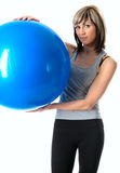 Sportswoman with a Fitness Ball Stock Images
