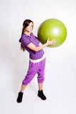Sportswoman With A Fitness Ball Royalty Free Stock Image
