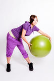 Sportswoman With A Fitness Ball Royalty Free Stock Photography