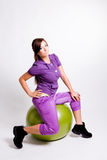 Sportswoman With A Fitness Ball Royalty Free Stock Images