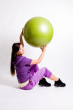 Sportswoman With A Fitness Ball Stock Photo