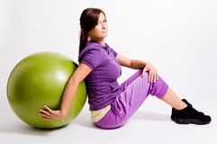 Sportswoman With A Fitness Ball Stock Photos
