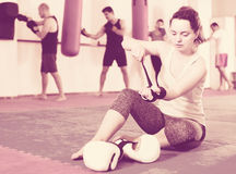Sportswoman on the floor is preparing for battle. In the boxing hall Stock Image