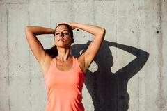 Sportswoman getting ready for working out Royalty Free Stock Photography