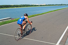 Sportswoman goes on a bicycle Royalty Free Stock Images