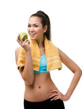 Sportswoman hands green apple Royalty Free Stock Images