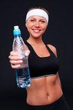 Sportswoman holding bottle of water Stock Image