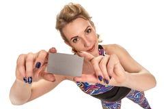 Sportswoman holding card Royalty Free Stock Photo