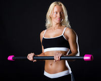 Sportswoman holding a fitbat Royalty Free Stock Photography