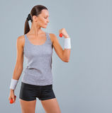A sportswoman holding small weights Stock Photos