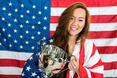 Sportswoman Holding Trophy Against North American Flag Royalty Free Stock Images