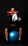 Sportswoman holding weights in gym room Royalty Free Stock Photo