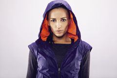 Sportswoman in hoodie looking at camera Stock Photography