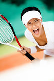 Sportswoman i leka tennis för sportswear fotografering för bildbyråer