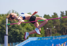 Sportswoman jumps in height Stock Photo