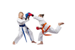 Sportswoman in karategi beats gyaku-tsuki in the jump Royalty Free Stock Photos
