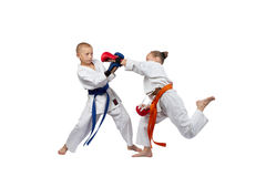 Sportswoman in karategi beats gyaku-tsuki in the jump Royalty Free Stock Photo