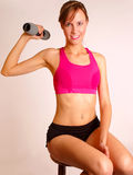 Sportswoman lifting dumbbell Royalty Free Stock Photos