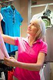 Sportswoman looking a polo shirt Stock Image