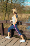 Sportswoman Lunging Outdoors. Royalty Free Stock Photography