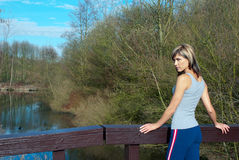 Sportswoman Lunging Outdoors. Royalty Free Stock Photos