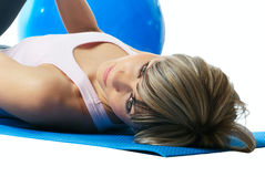 Sportswoman lying on a mat. Stock Photography