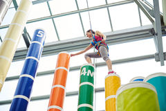 Sportswoman making a step on the column on the indoor sport venu Stock Images