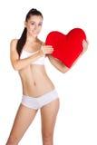 Sportswoman med rad-hjärta som isoleras på white Arkivfoto