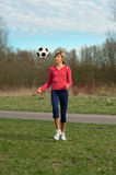 Sportswoman Playing with a Ball Royalty Free Stock Image