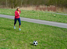 Sportswoman Playing with a Ball Royalty Free Stock Photography
