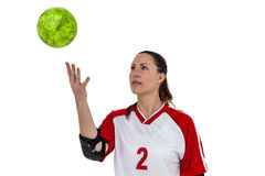 Sportswoman playing with ball Stock Photo