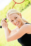 Sportswoman plays badminton Royalty Free Stock Images