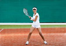 Sportswoman plays tennis Stock Photos